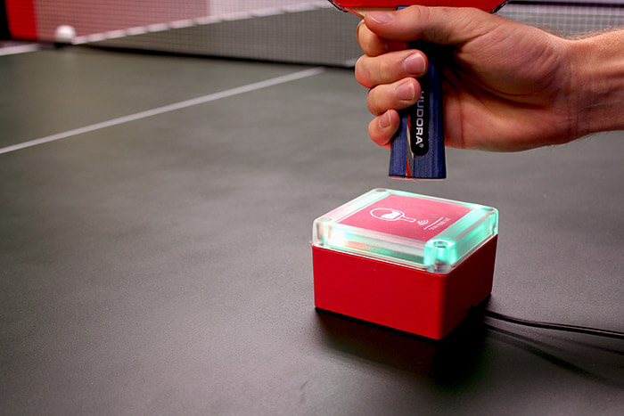 Scanning the ping pong paddle over the RFID chip reader
