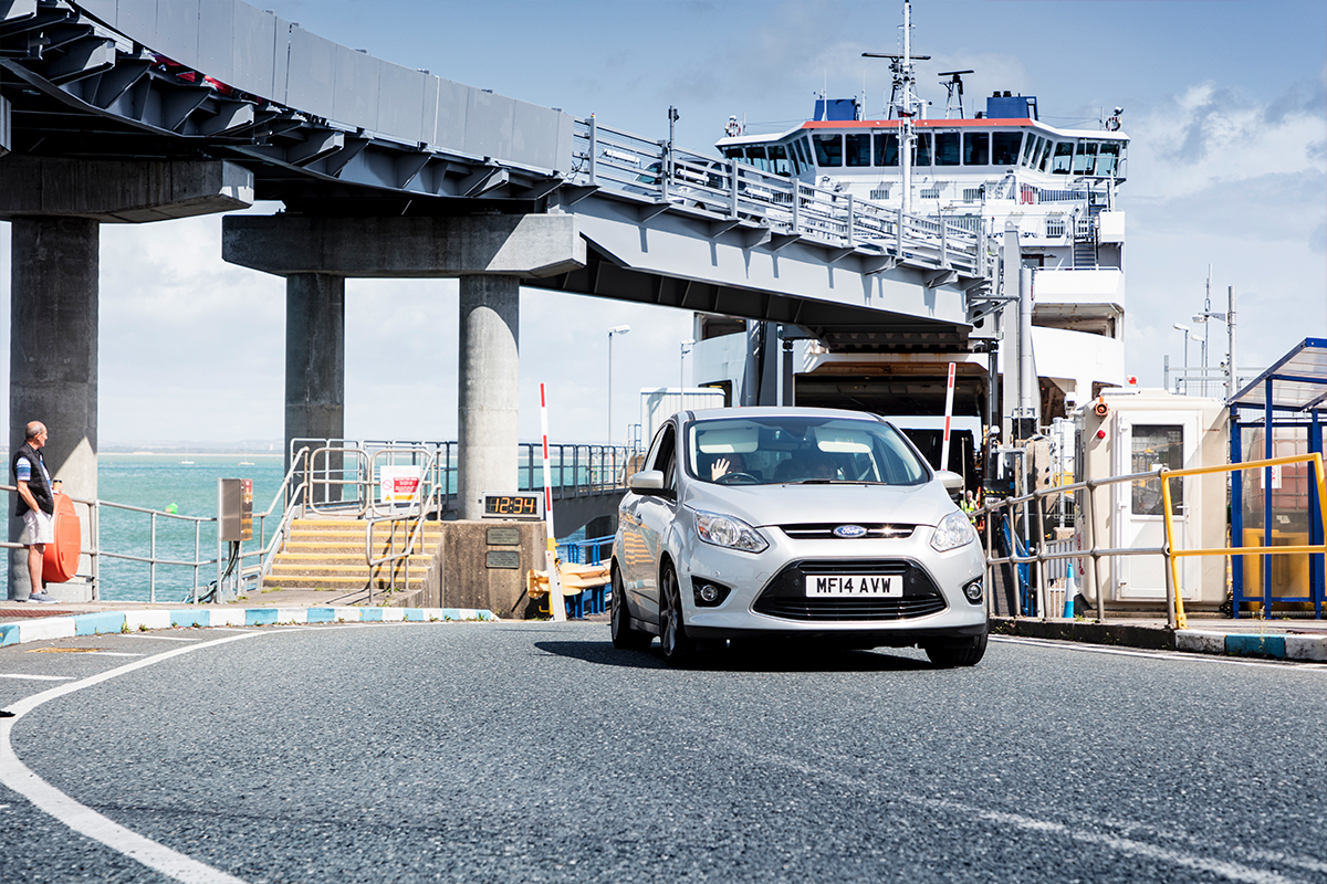vehicle driving away from ferry at port