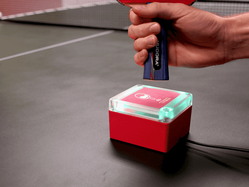 Scanning a ping pong paddle over a RFID reader